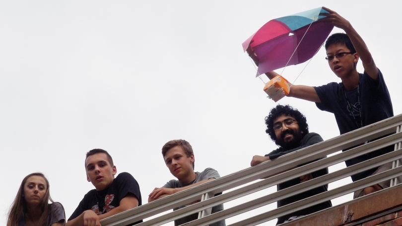 Students prepare to drop and egg in a student built parachute.