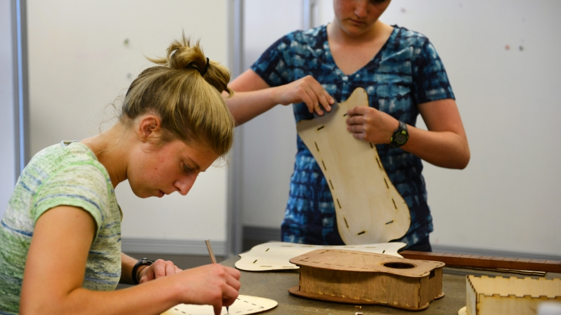 Students work on building guitars.