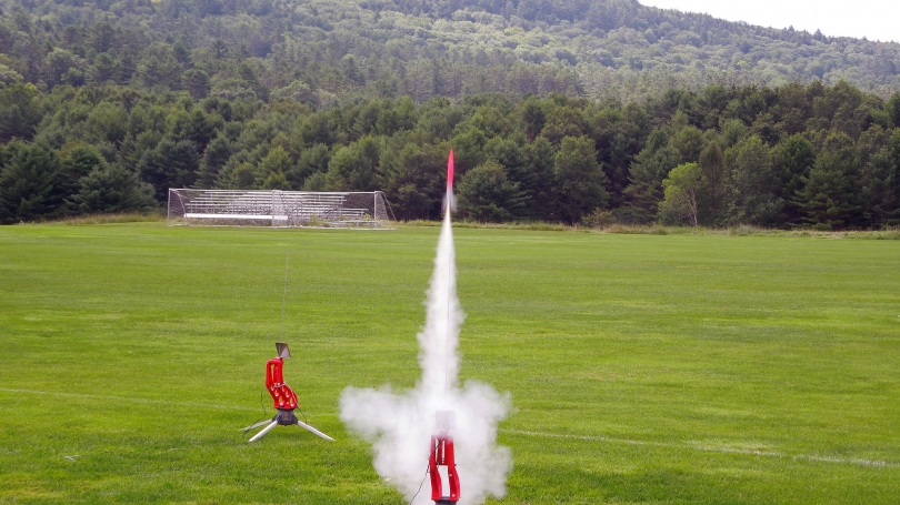 A student-built rocket takes off.